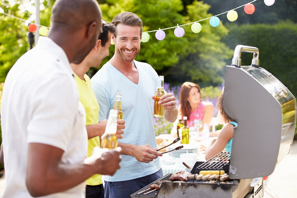 Group of men cooking a barbeque