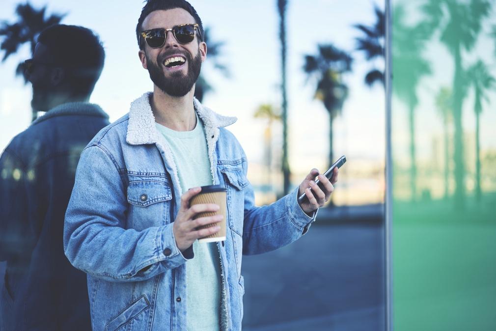 Man using international roaming on phone