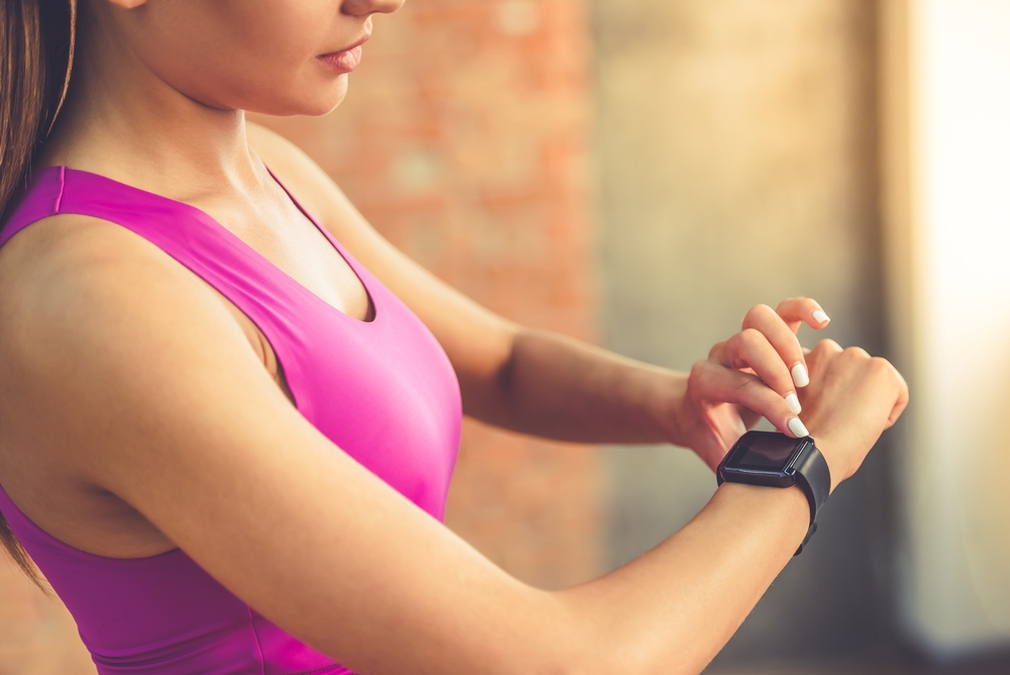 Woman tracking fitness with a Fitbit