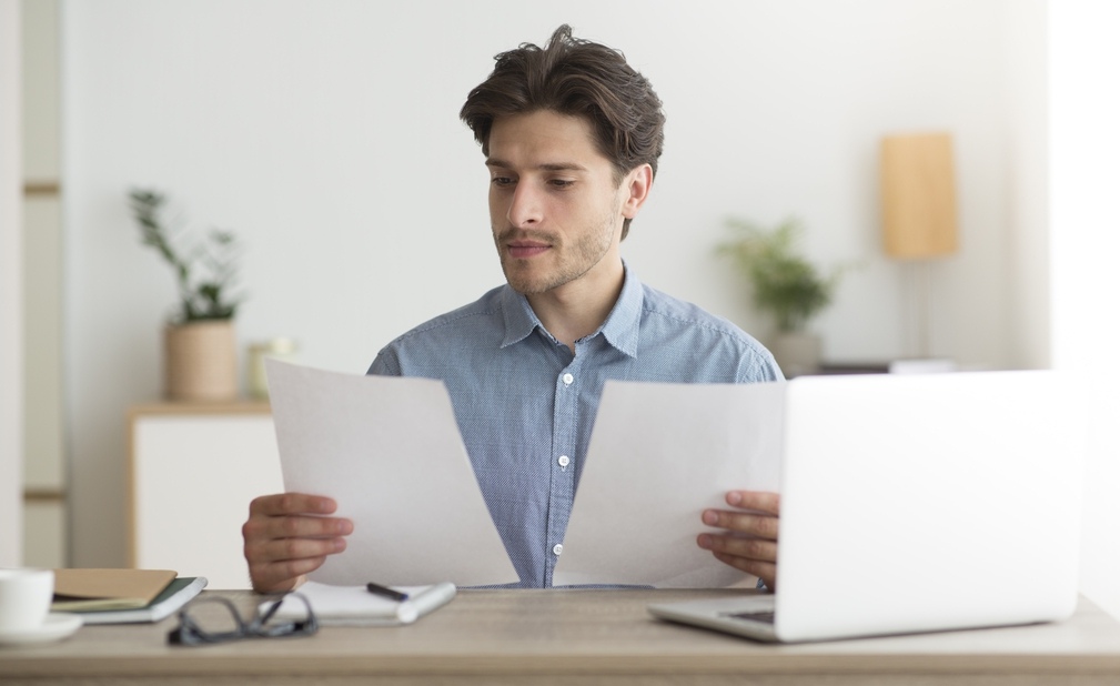 Business man looking at pieces of paper