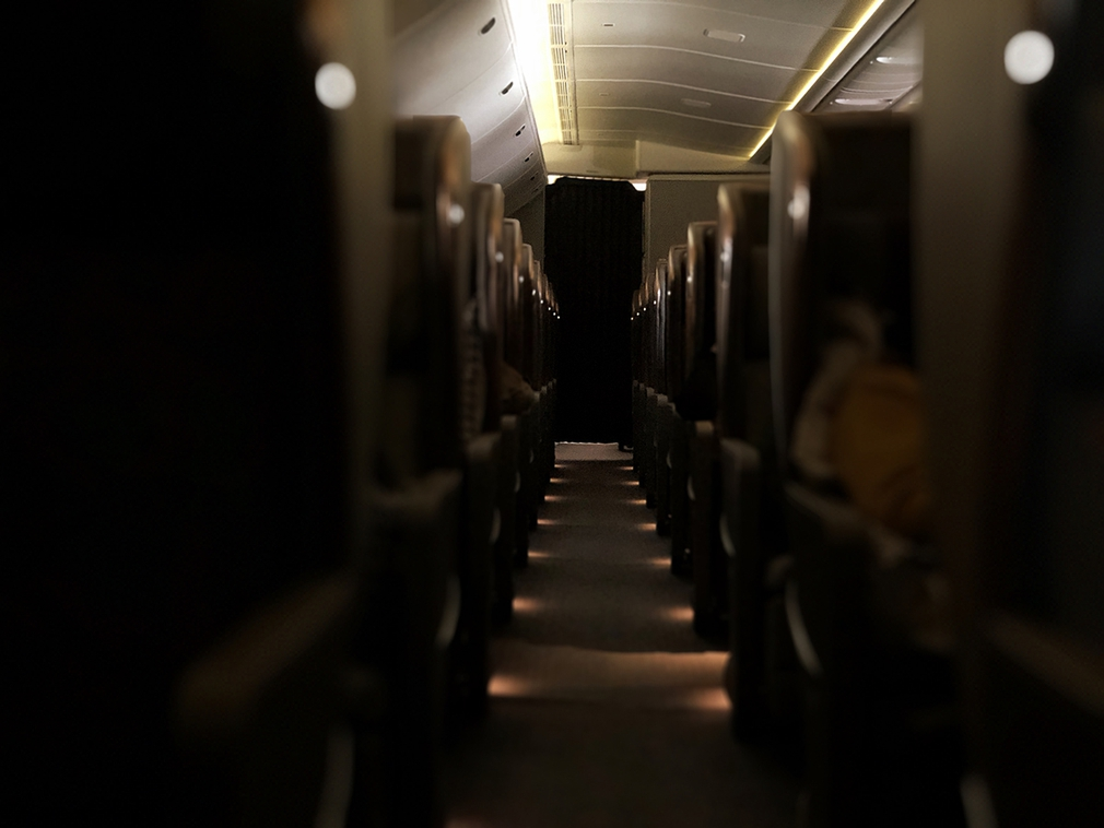 Low lights down the aisle in Singapore Airlines Business Class cabin