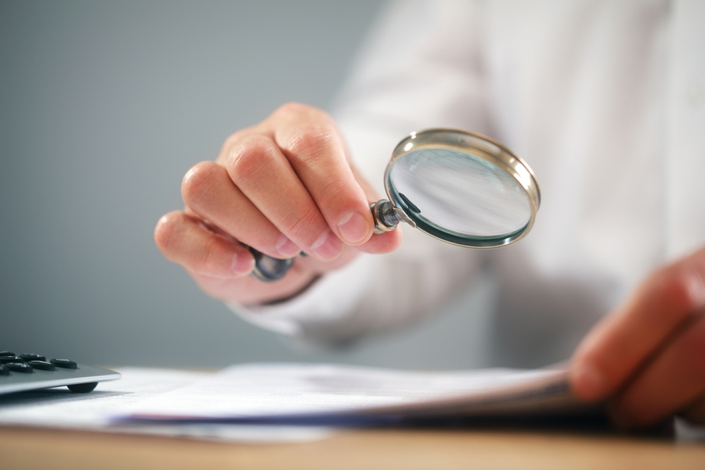 Using magnifying glass to read small print