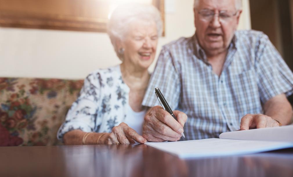 Seniors signing documents