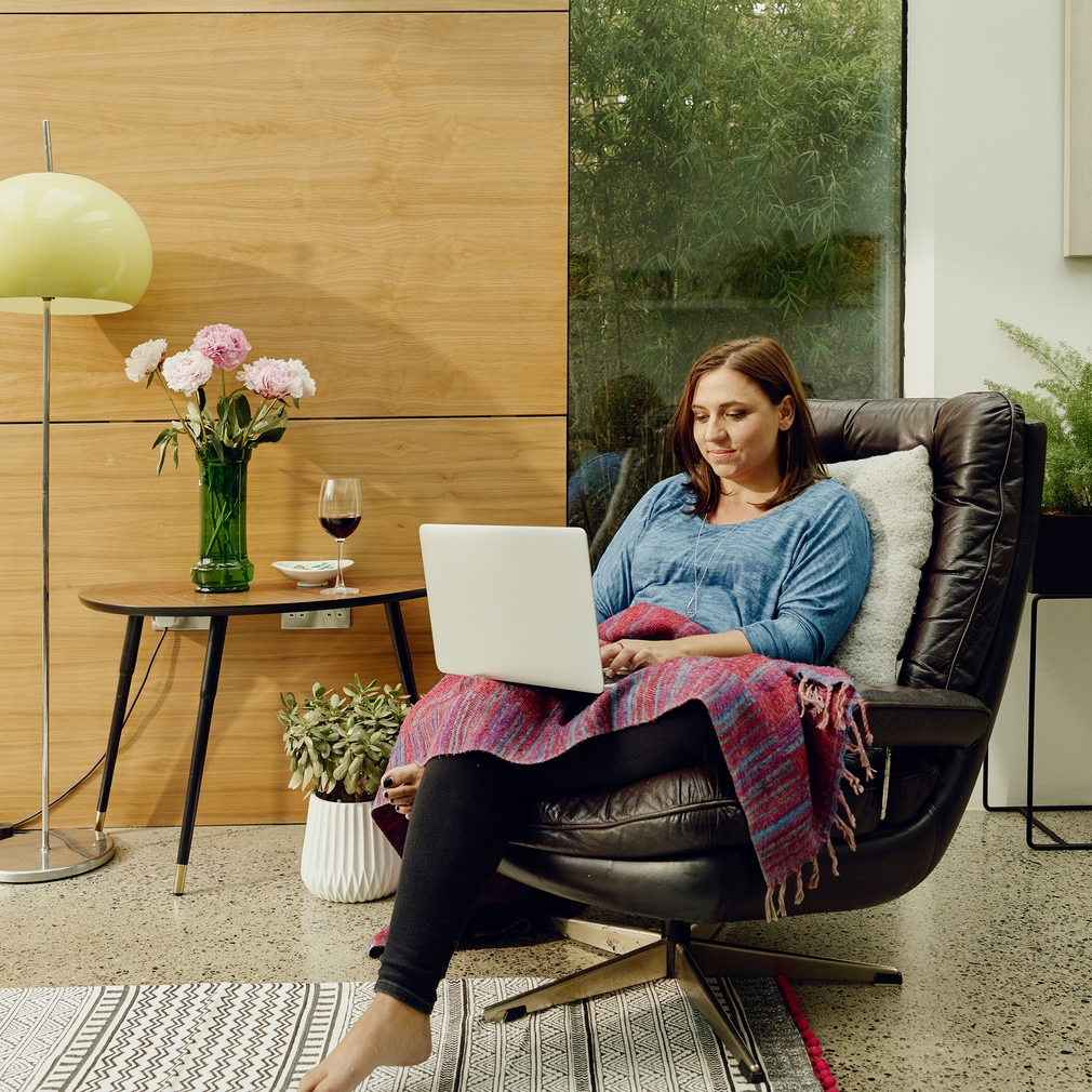 woman on laptop with feet up