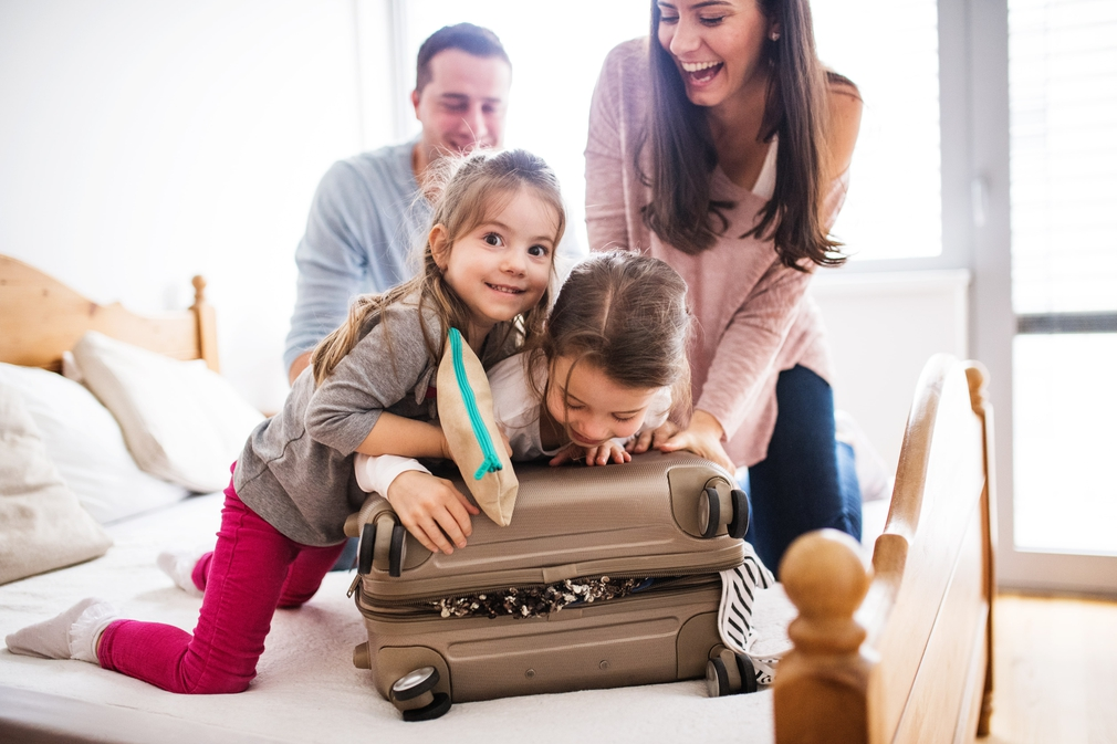 Family packing a suitcase