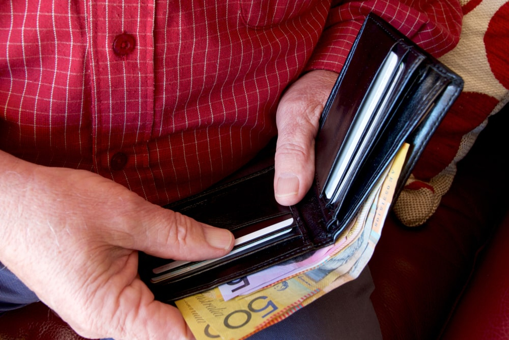 Man reaching for credit card in wallet