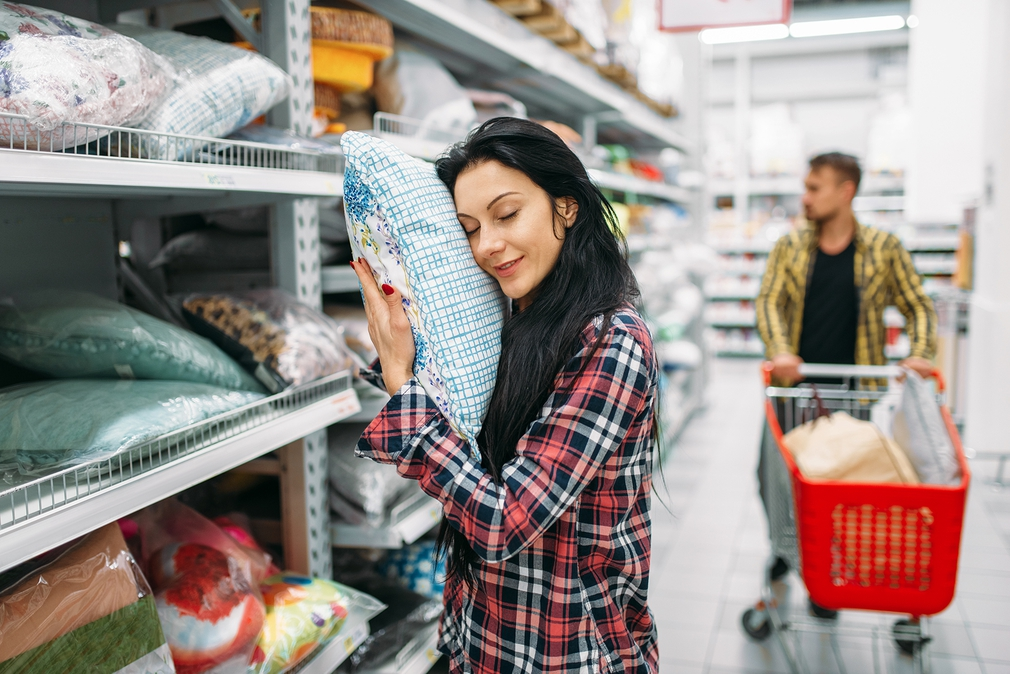 Woman hugging kmart pillow