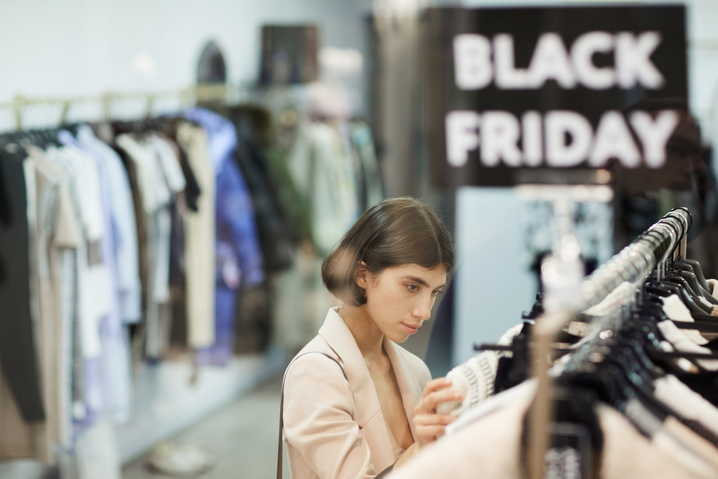 Woman shopping on Black Friday in a clothing store