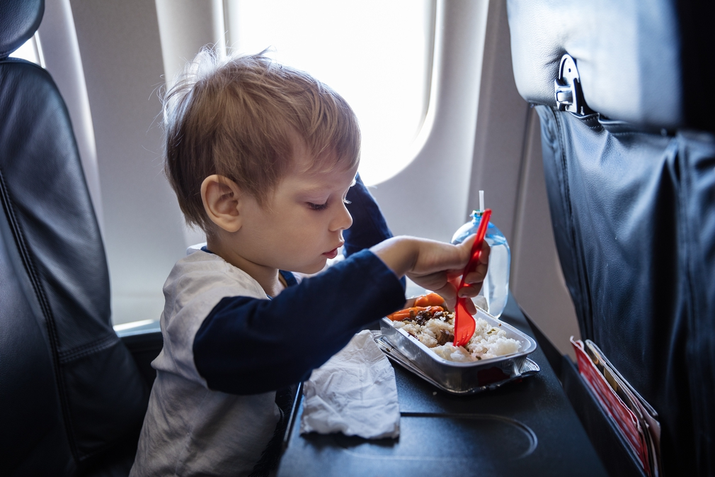 Boy eating on a plane