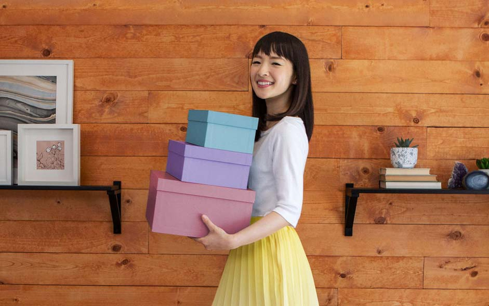 Marie Kondo Holding Boxes