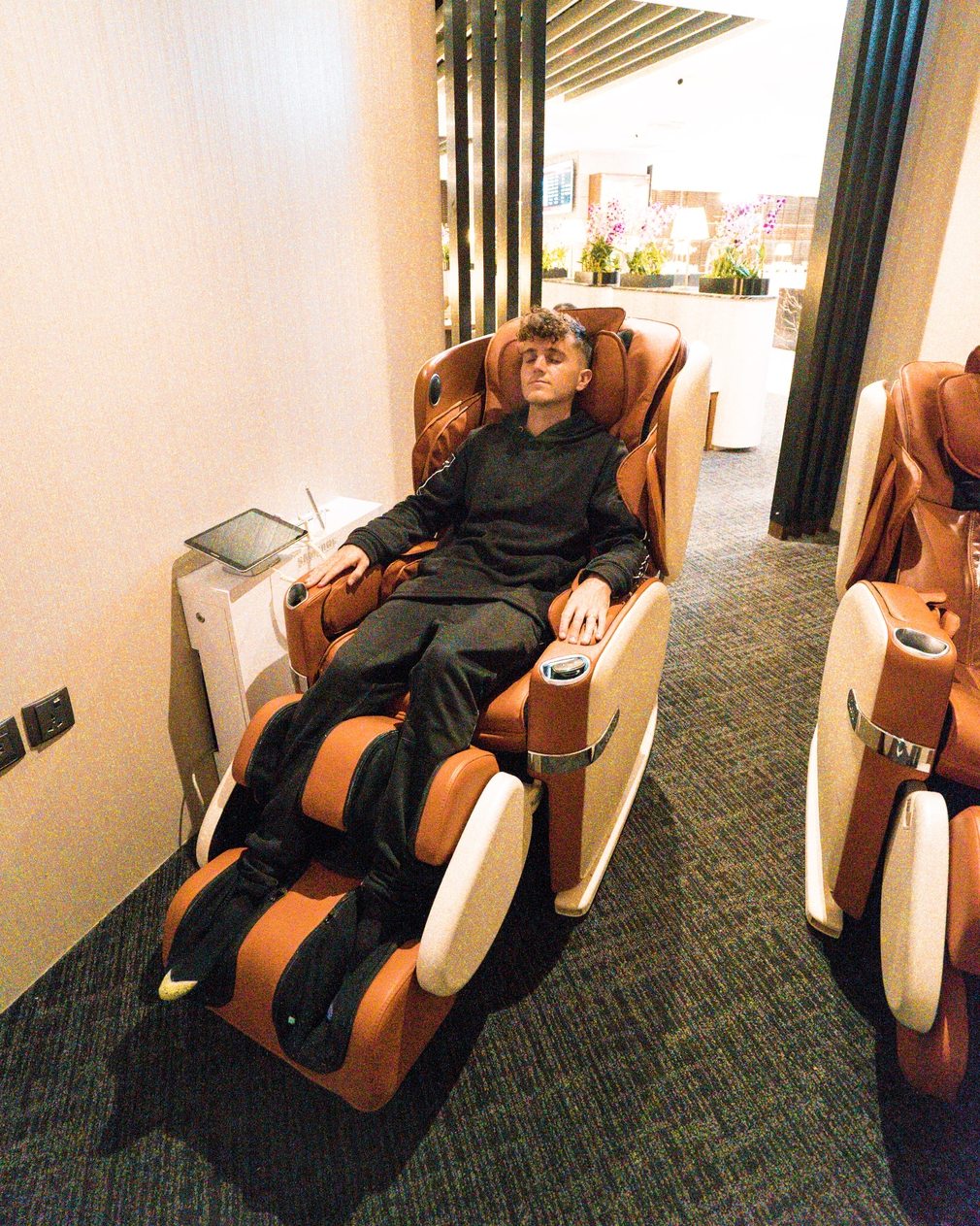 massage chairs in the SATS lounge
