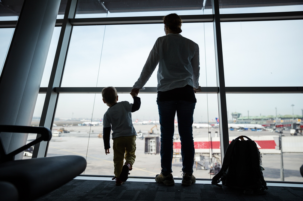 Parent and child looking at planes