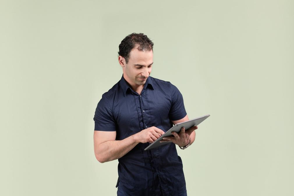 Man checking credit score on iPad