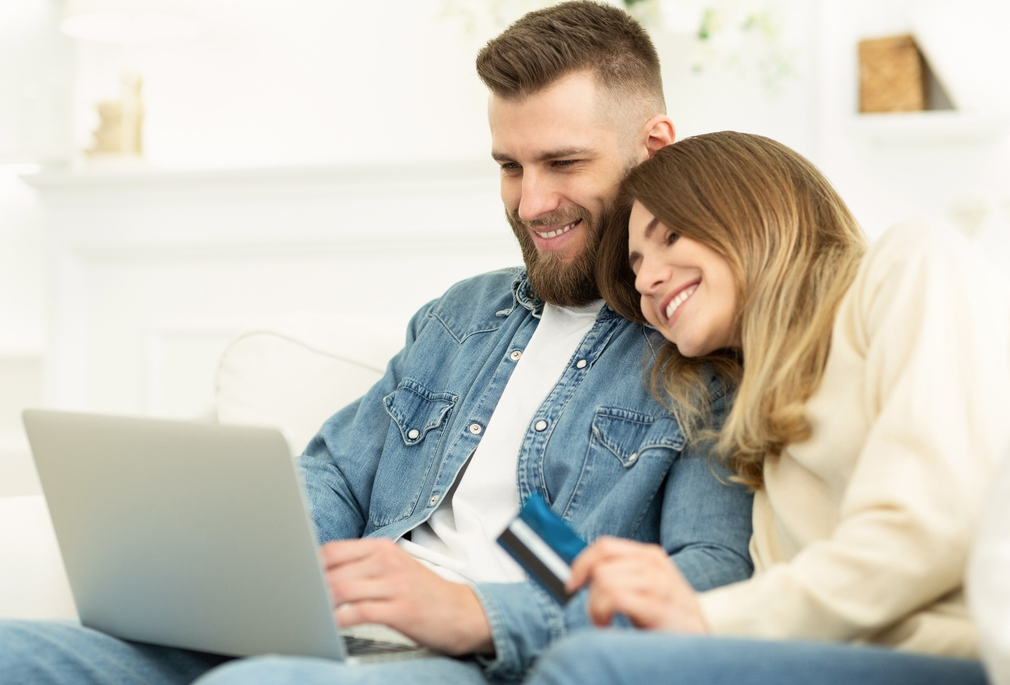 Young couple online shopping together