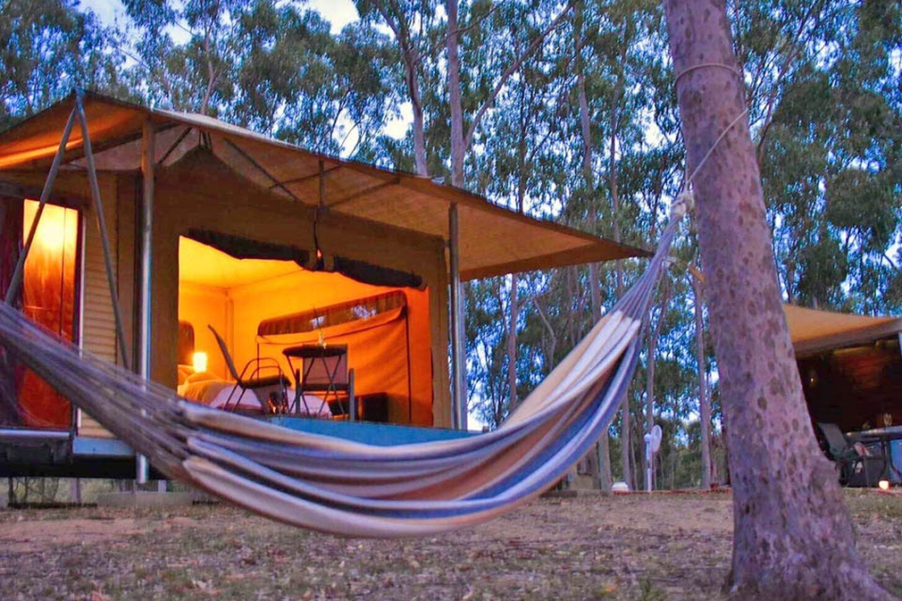 Hammock with glamping tent in background