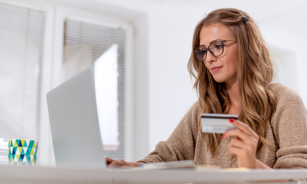 woman paying for items online using laptop