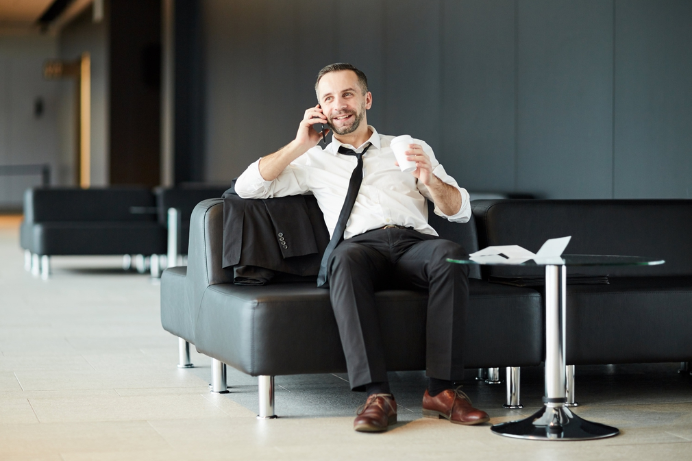 Business man on the phone in airport