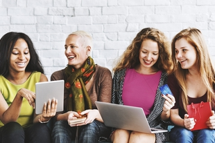 Women online shopping together