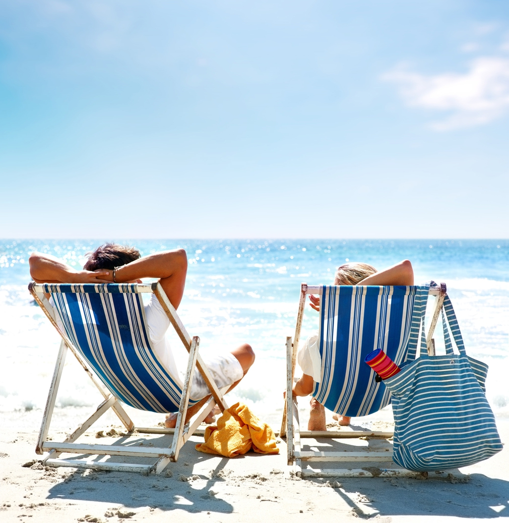 Couples in beach chairs