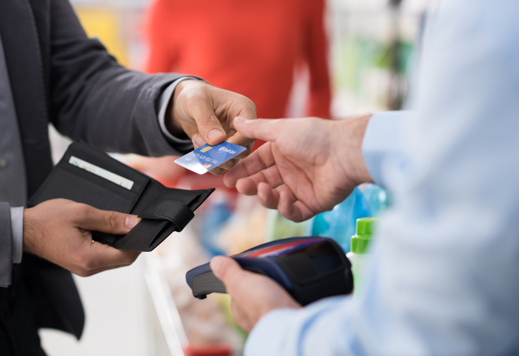 Boss handing over credit card to employee