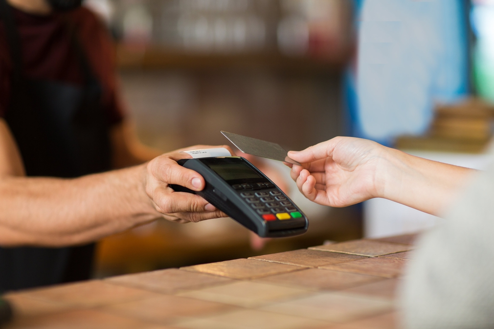 paying at a business with a credit card on an EFTPOS machine