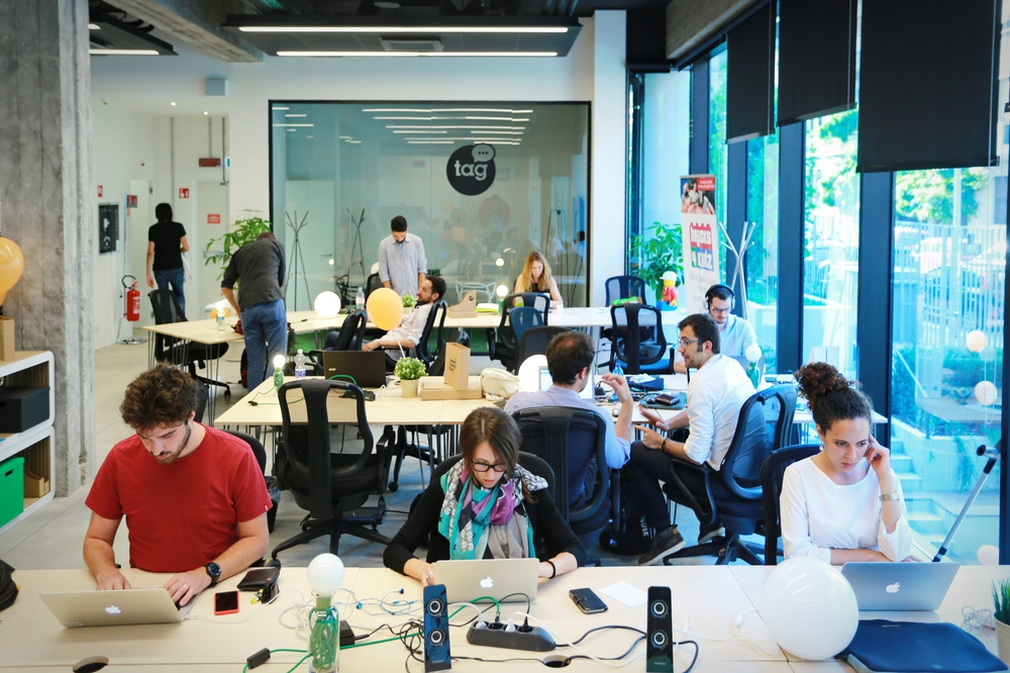 People working in a co-working space