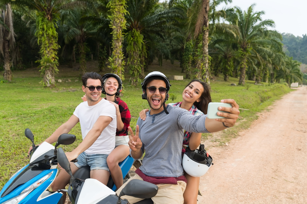 two couples riding motorbikes together