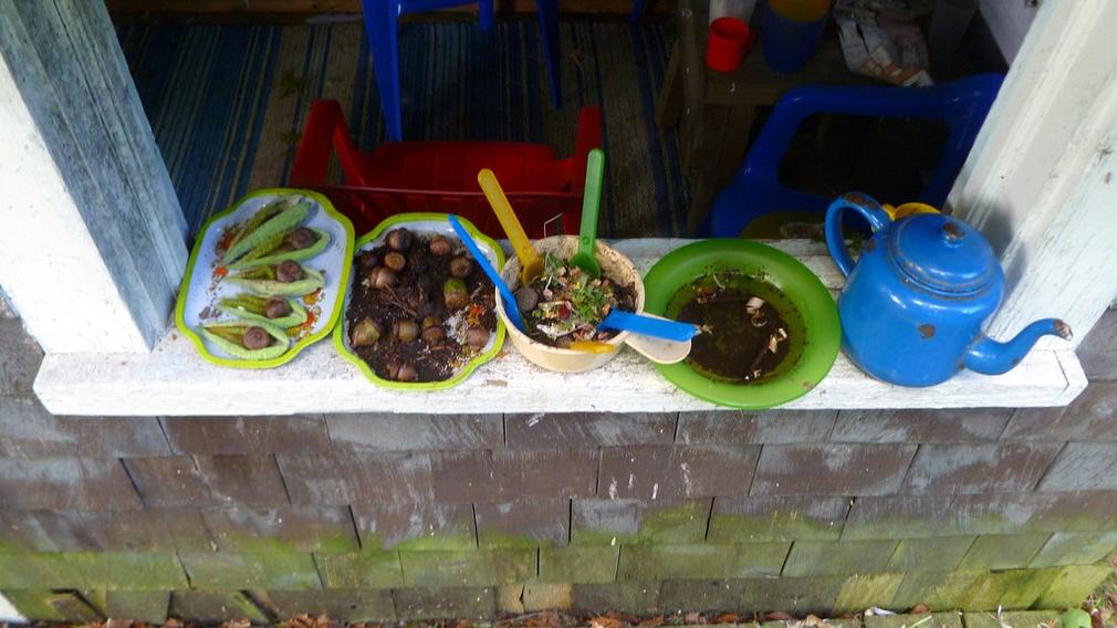 Kids making mud pies
