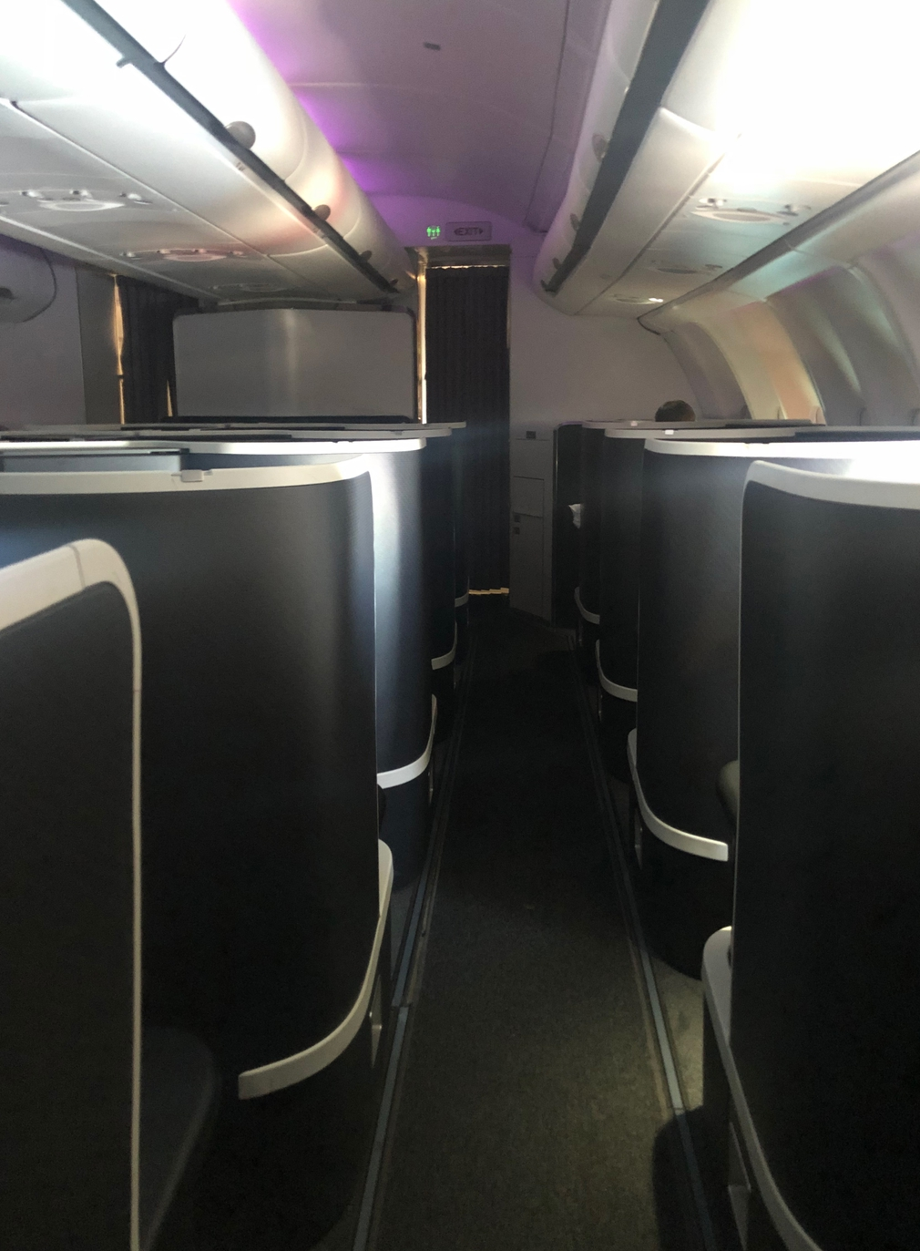 Looking up the Business Class aisle with high-sided seats