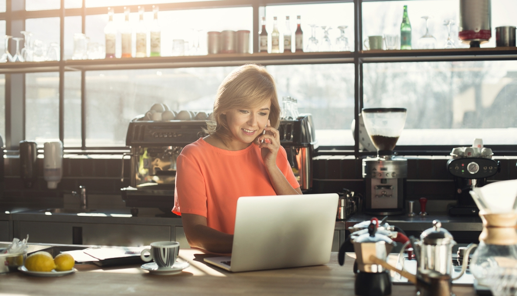 Woman looking at laptop for online purchases