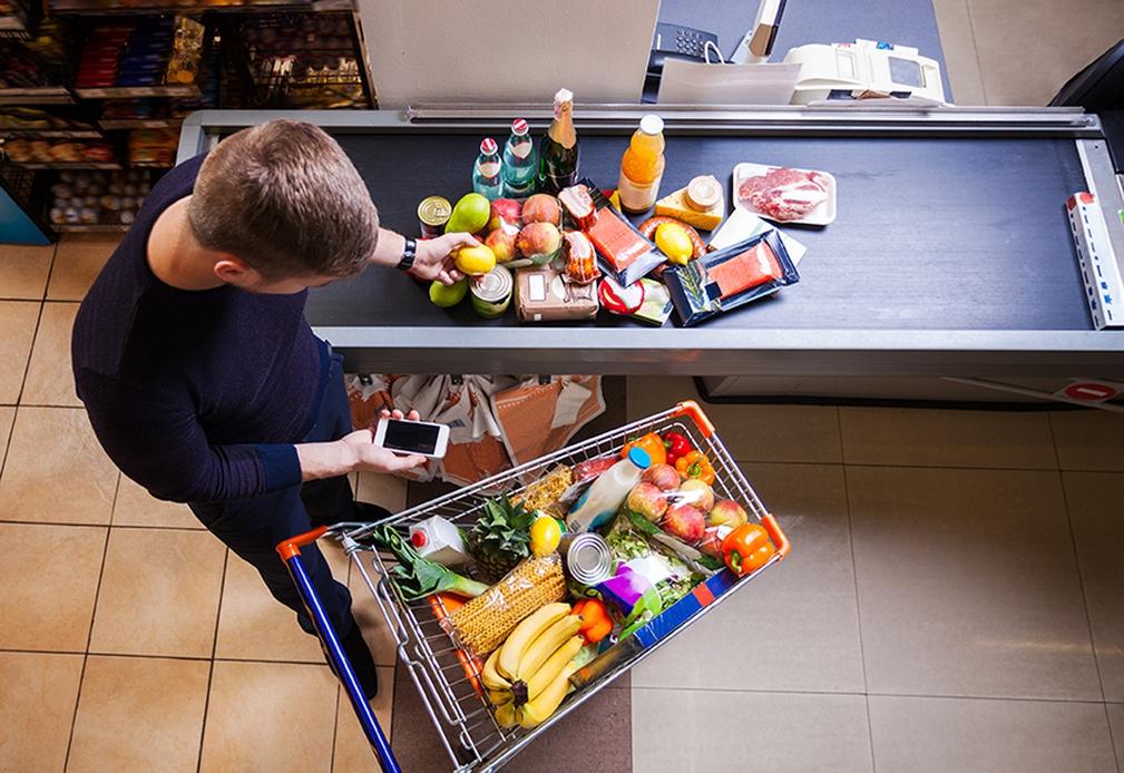 Man with shopping cart at checkout