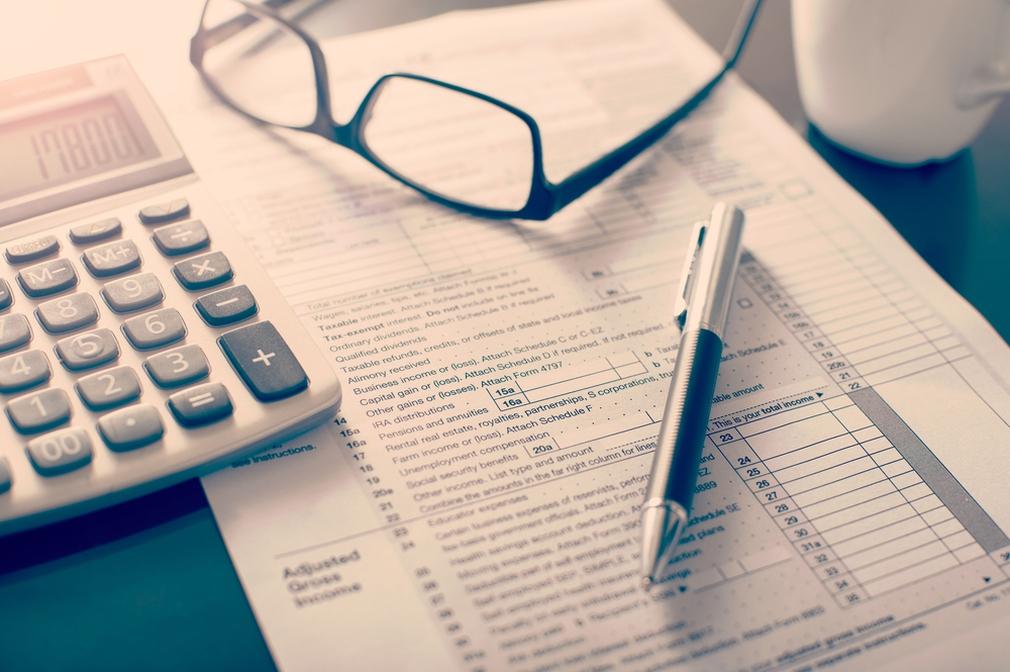 Tax bill, pen and calculator