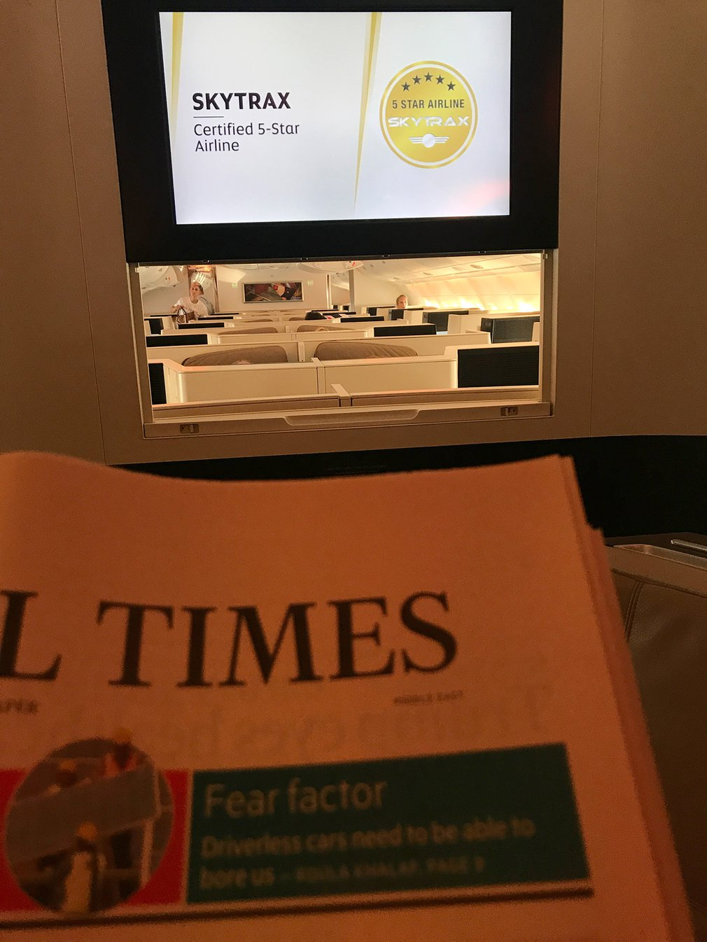 Reading the Financial Times in the business class bar & lounge