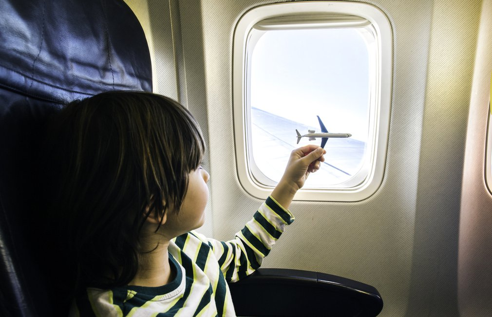 Child plays with toy plane